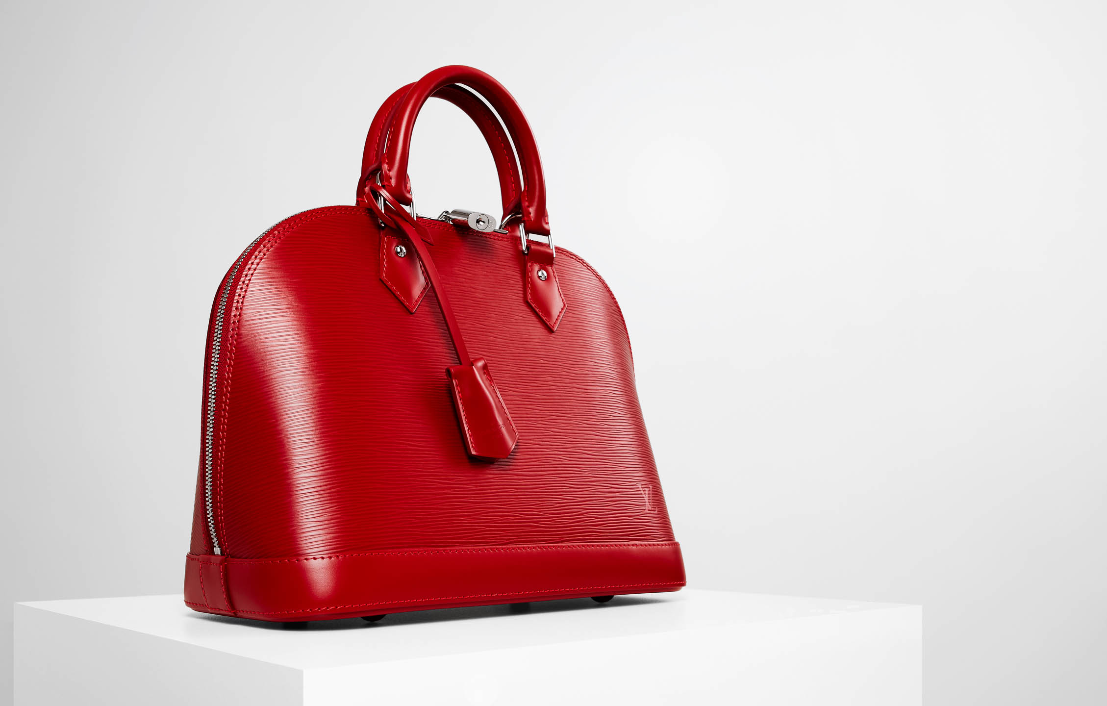 Louis Vuitton red Alma handbag by Steve Temple Photography