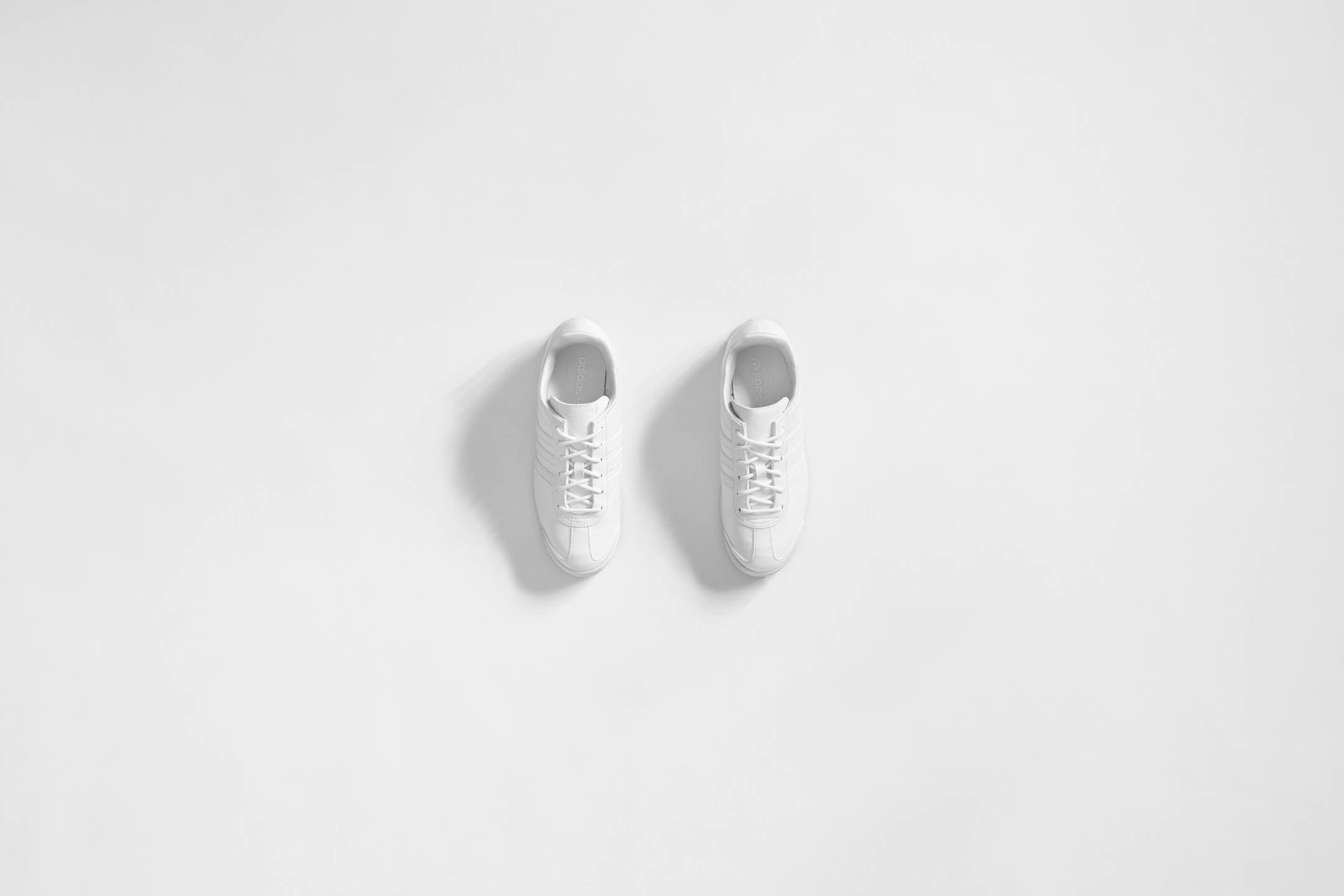 Adidas white sneakers by Steve Temple Photography