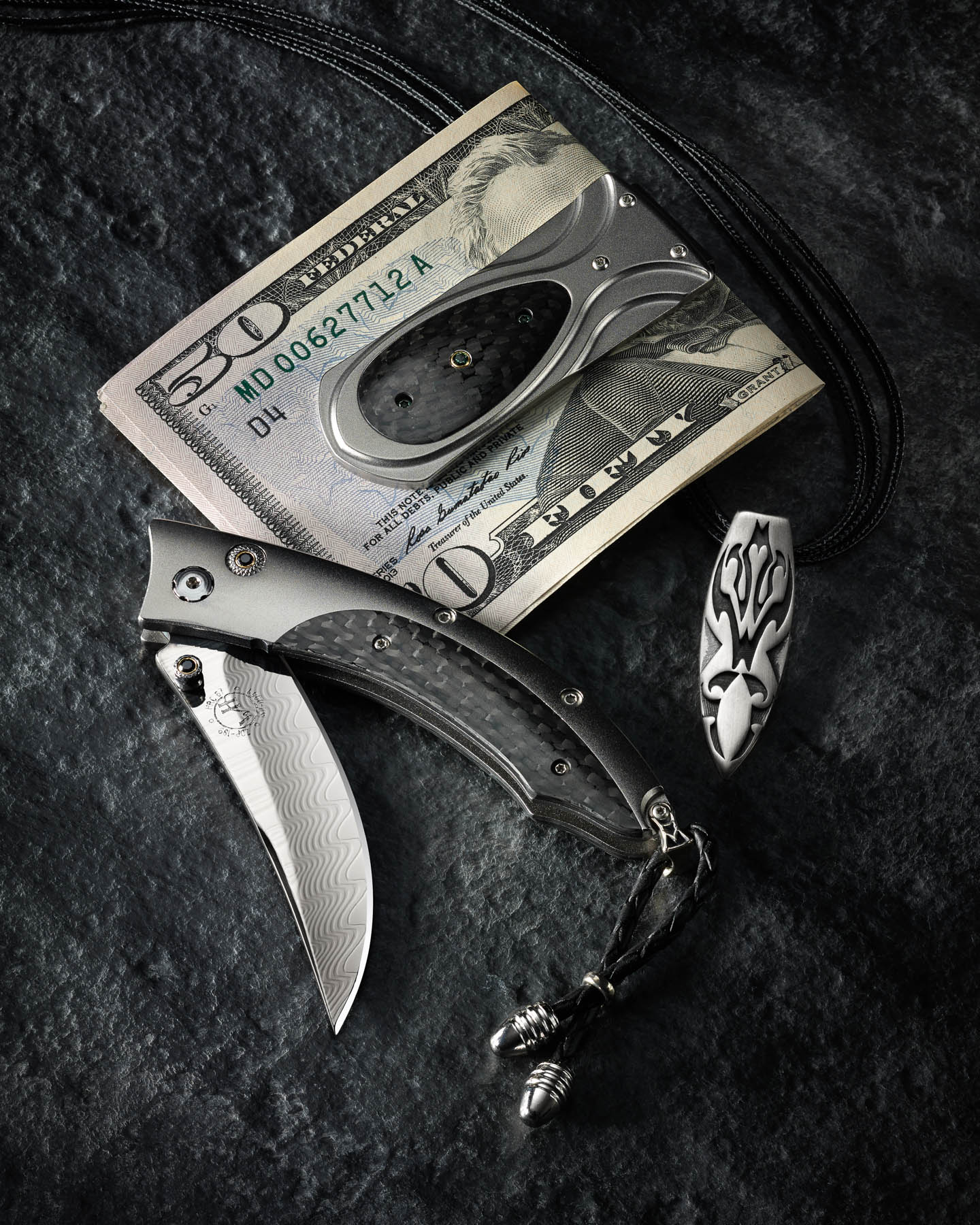 William Henry money clip, knife, and necklace on slate by Steve Temple Photography